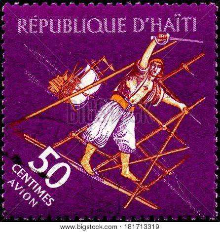 UKRAINE - CIRCA 2017: A postage stamp printed in Haiti shows Pirate with saber from the series Tourism. History of Tortuga Island circa 1961