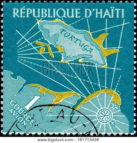 UKRAINE - CIRCA 2017: A postage stamp printed in Haiti shows Map of Tortuga Island from the series Tourism. History of Tortuga Island circa 1961