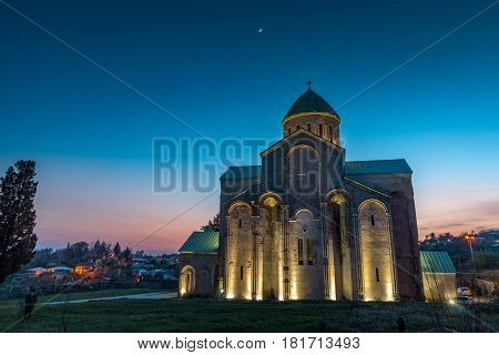 GEORGIA, KUTAISI - April 02, 2017: Night view on Bagrati Cathedral or The Cathedral of the Dormition is an 11th century cathedral in Kutaisi, Georgia.
