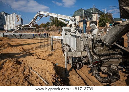Concrete injection machine is pouring concrete into concrete pump for casting.