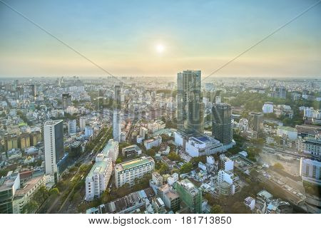 Ho Chi Minh City, Vietnam - April 11, 2017: High view Saigon skyline when the sun shines down urban areas with tall buildings along the road many trees show development country in Ho Chi Minh, Vietnam