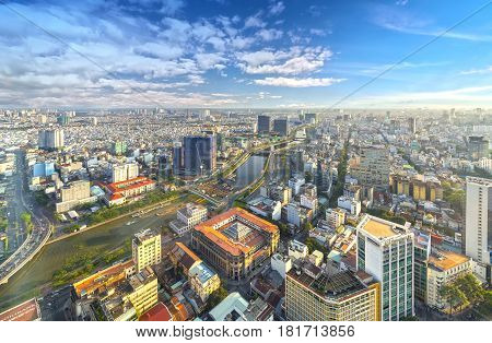 Ho Chi Minh City, Vietnam - April 11, 2017: High view of Saigon skyline when the afternoon sun shines down urban areas with tall buildings along the river showing the development of the country in Ho Chi Minh City, Vietnam