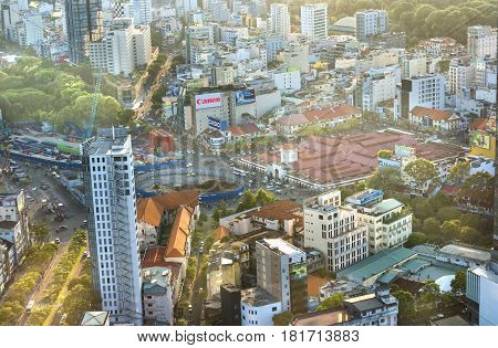 Ho Chi Minh City, Vietnam - April 11, 2017: Ben Thanh Market Center viewed from above with skyscrapers is gradually shaping the development of active urbanization in Ho Chi Minh City. Minh, Vietnam