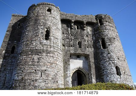 Kidwelly, Wales, UK, September 25, 2015 : Kidwelly Castle gatehouse by the River Gwendraeth is a ruin of a 13th century medieval castle and a popular tourist attraction
