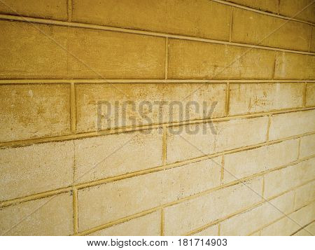 Dark yellow brick wall And pale yellow. Suitable for background