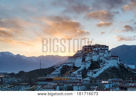 the potala palace in lhasa with beautiful sunset sky