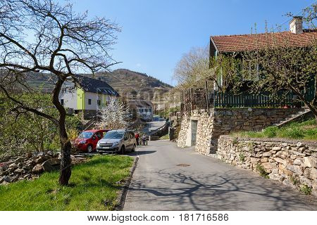 WEISSENKIRCHEN-IN-DER-WACHAU/ AUSTRIA - APRIL 1, 2017. Market town of Weissenkirchen in der Wachau, surrounded with terraced vineyards. Wachau-Valley, district of Krems-Land, Lower Austria.