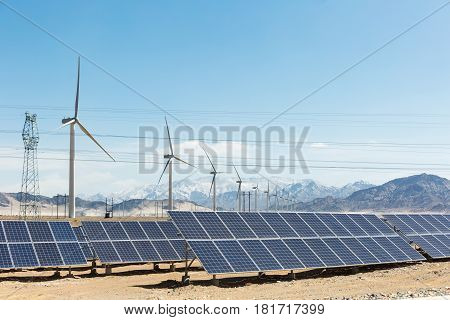 clean energy on snow area plateau solar panels and wind power farm in golmud China
