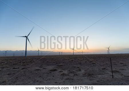 wind farm in sunset on wilderness gobi qinghai China