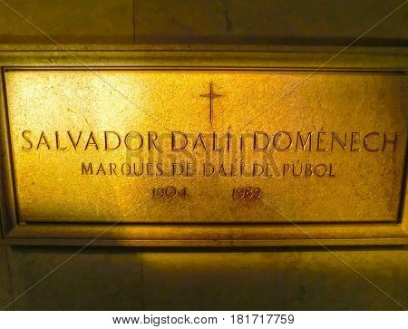 Figueres, Spain - September 15, 2015: Board on the wall in the room where Dali was buried at Dali Museum in Figueres, Spain on September 15, 2015. Museum was opened on September 28, 1974 and houses largest collection of works by Salvador Dali.