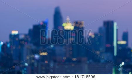 City office building blurred bokeh light at twilight abstract background