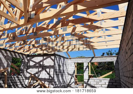 Roof trusses construction. Wooden Roof Frame House Construction. Roofing Construction.