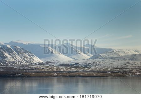 Winter mountain natural landscape over the lake Iceland