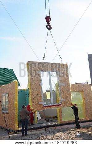 KIEV - UKRAINE APRIL - 19, 2017: Builders Building New Frame House. Structural Insulated Panels (SIPS) technology is the building technology of the future.