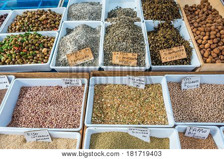 Chickpeas olives capers and beans on market place of the old part of Syracuse - Ortygia isle Sicily Italy