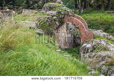 Roman Amphitheater in Neapolis Archaeological Park in Syracuse Sicily Island of Italy