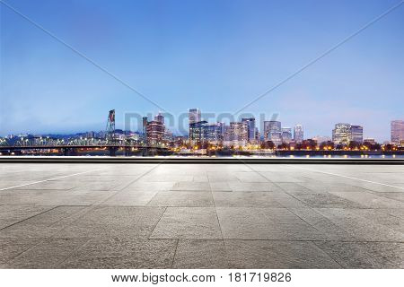 cityscape of portland at twilight from empty brick floor