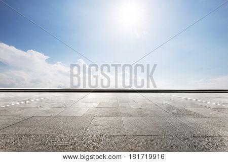 blue sunny sky from empty brick floor