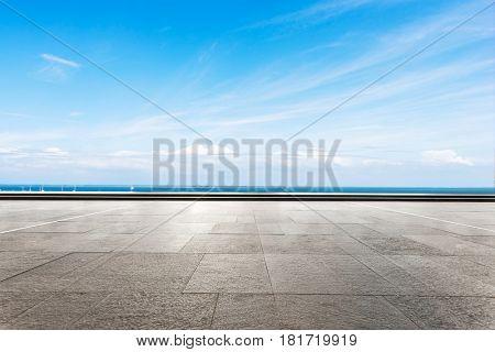 blue sea and sunny sky from empty brick floor