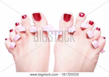 Close-up of female feet with red polished nails carefree chiropody