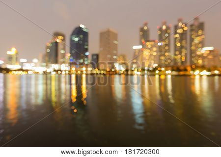 Night blurred bokeh Office building river reflection abstract background