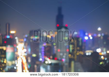 Night blurred bokeh city downtown aerial view abstract background
