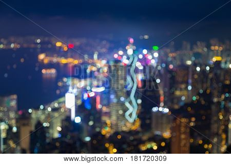 Aerial view blurred bokeh night Hong Kong business downtown over Victoria Bay abstract background