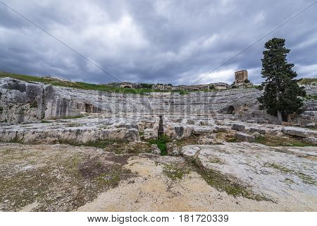 View of stage and auditorium of Greek theater in Neapolis Archaeological Park in Syracuse Sicily Island of Italy