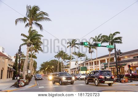 Naples Fl USA - March 21 2017: Street with illuminated palm trees in the city of Naples. Florida United States
