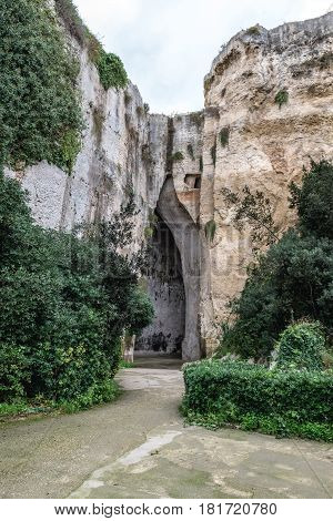 So called Ear of Dionysius cave in ancient quarry Neapolis Archaeological Park in Syracuse Sicily Island of Italy