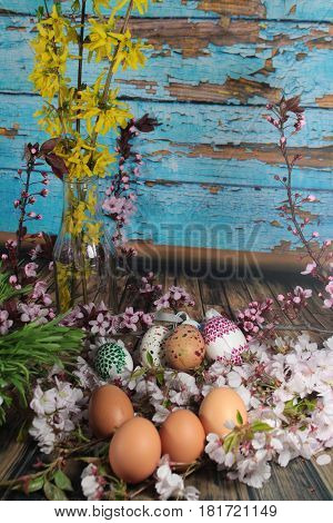 Painted Easter egg with cherry branch/ Easter eggs and cherry branch.