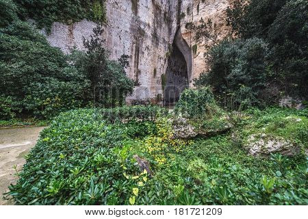 Cave called Ear of Dionysius in ancient quarry Neapolis Archaeological Park in Syracuse Sicily Island of Italy