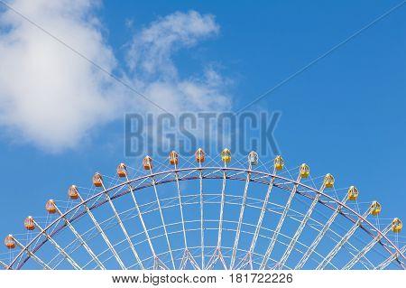Part of Big festival funfair ferris wheel with blue sky background