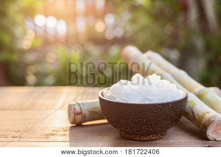 Rock Sugar And Sugar Cane On Wooden Table With Sunlight Blur Background