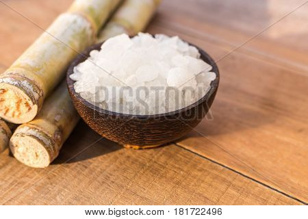 Rock Sugar And Sugar Cane On Wooden Table Background With Sunlight In Morning Time