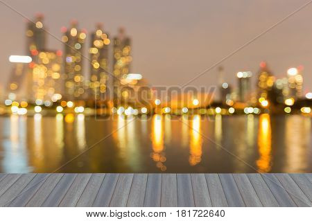 Opening wooden floor Blurred bokeh office building water front abstract background