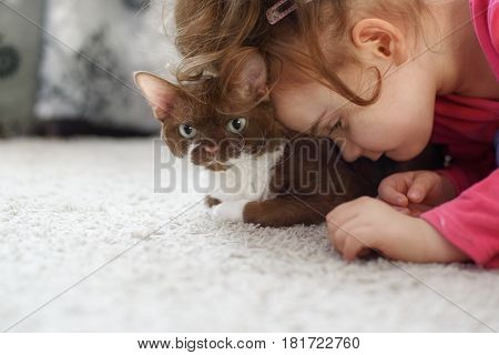 Lonely autistic girl looking and her cat