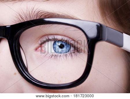 Portrait Of A Boy Wearing Eyeglasses Blue Eyes Close, Macro Studio Shot