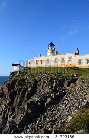 Rugged rocky cliffs at Neist Point Lighthouse in Scotland.