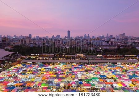 Top view city night market multiple colour roof top with city downtown and sunset sky background