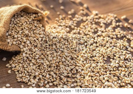 Millet Rice Or Millet Grains In Small Sack On Wooden Table Background