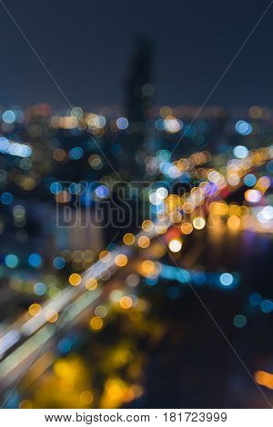 Aerial view blurred bokeh light Bangkok city night view abstract background