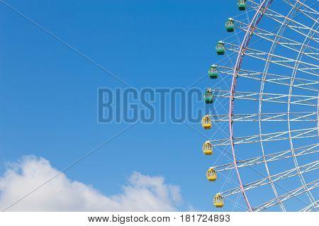 Big funfair giant ferris wheel with blue sky background