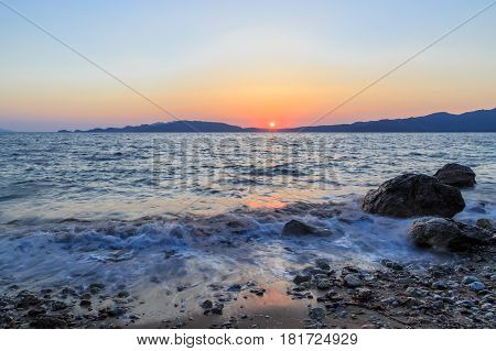 Beuatiful waves of mediterranean sea during sunset near hisaronu marmaris
