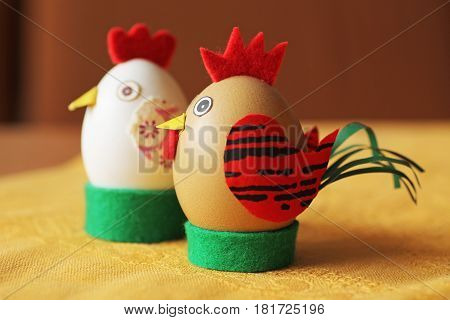 funny easter eggs decorated like cock and hen
