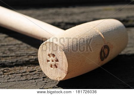 close photo of wooden mallet for carvery