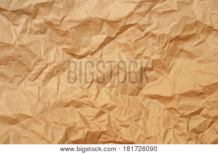 Crumpled craft brown paper texture for background