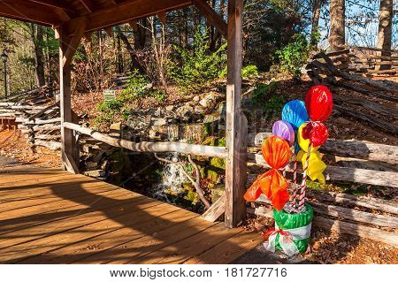 Little waterfall bridge over the creek and Christmas decorations Helen USA