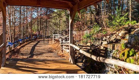 Little waterfall bridge over the creek and footpath Helen USA