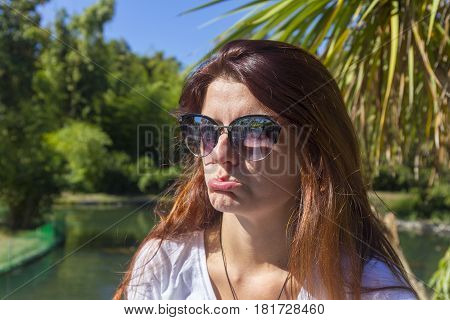 Young beautiful woman emotional portrait at the park